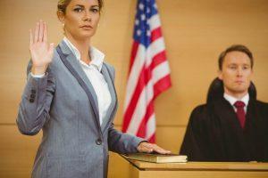 Witness swearing on bible