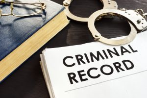criminal record with handcuffs